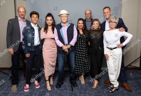 """Writer Mike Royce, from left, cast members Marcel Ruiz, Isabella Gomez, producer Norman Lear, writer Gloria Calderon Kellett, cast members Stephen Tobolowsky, Justina Machado, Rita Moreno and producer Brent Miller, from the Netflix series """"One Day at a Time"""" pose for a photo during the Netflix portrait session at the Television Critics Association Summer Press Tour at The Beverly Hilton hotel, in Beverly Hills, Calif"""