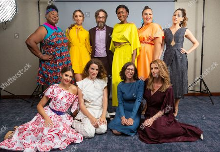 """Kia Stevens, from left, Alison Brie, Britt Baron, Liz Flahive, Marc Maron, Sydelle Noel, Carly Mensch, Britney Young, Betty Gilpin and Jackie Tohn, cast members and showrunners of the Netflix series """"Glow,"""" pose for a photo during the Netflix portrait session at Television Critics Association Summer Press Tour at The Beverly Hilton hotel, in Beverly Hills, Calif"""