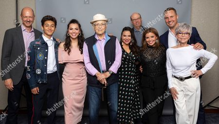 """Writer Mike Royce, from left, Marcel Ruiz, Isabella Gomez, producer Norman Lear, writer Gloria Calderon Kellett, Stephen Tobolowsky, Justina Machado, Rita Moreno and producer Brent Miller, cast members of the Netflix series """"One Day at a Time"""" pose for a photo during the Netflix portrait session at Television Critics Association Summer Press Tour at The Beverly Hilton hotel, in Beverly Hills, Calif"""