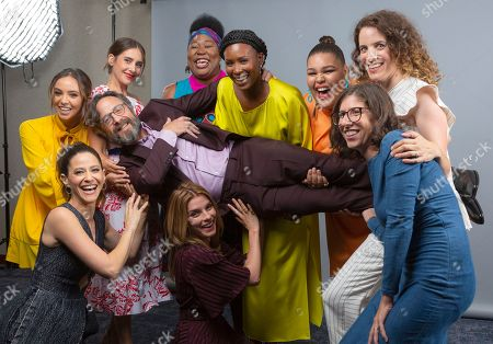 """Britt Baron, from left, Alison Brie, Kia Stevens, Sydelle Noel, Britney Young, Liz Flahive, Carly Mensch, Betty Gilpin, Jackie Tohn and Marc Maron, cast members and showrunners of the Netflix series """"Glow"""" pose for a photo during the Netflix portrait session at Television Critics Association Summer Press Tour at The Beverly Hilton hotel, in Beverly Hills, Calif"""