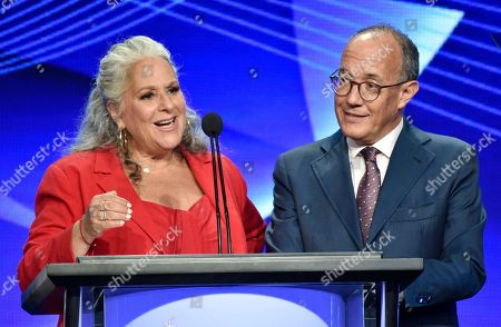 """Marta Kauffman, left, and David Crane, co-creators of the television series """"Friends,"""" accept the Heritage Award at the 34th annual TCA Awards during the 2018 Television Critics Association Summer Press Tour, in Beverly Hills, Calif"""
