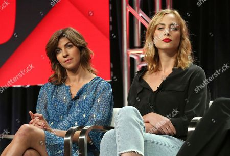 """Natalia Tena, left, and Nora Arnezeder participate in the """"Origin"""" panel during the YouTube Television Critics Association Summer Press Tour at The Beverly Hilton hotel, in Beverly Hills, Calif"""
