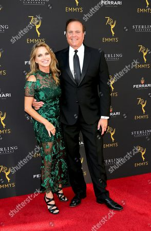 Dorothy Lucey, left, and David Goldstein arrive at the 70th Los Angeles Area Emmy Awards, at the Saban Media Center at Television Academy's North Hollywood, Calif. headquarters on