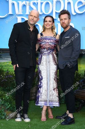 Director Marc Forster, left, with actors Ewan McGregor and Hayley Atwell pose for photographers upon arrival at the European Premiere of the film 'Christopher Robin', in a central London cinema