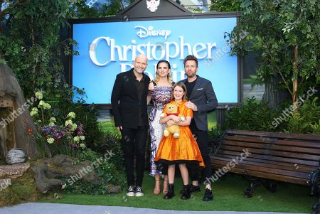 Director Marc Forster, left, with actors Ewan McGregor, Hayley Atwell, Bronte Cramichael holding Pooh the bear, pose for photographers upon arrival at the European Premiere of the film 'Christopher Robin', in a central London cinema