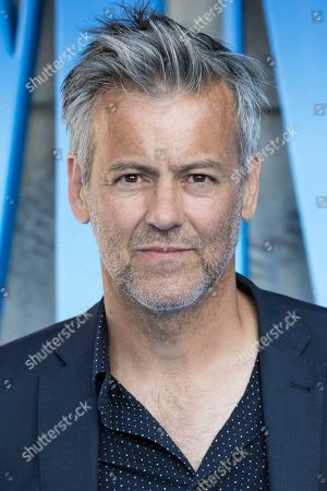 Rupert Graves poses for photographers upon arrival at the premiere of the film 'Mamma Mia! Here We Go Again', in London