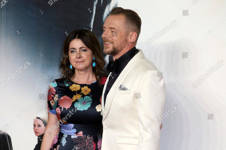 Actor Simon Pegg and partner Maureen Pegg pose for photographers on arrival at the premiere of the film 'Mission: Impossible - Fallout', in London