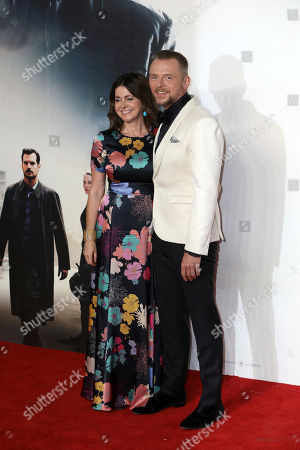 Stock Picture of Actor Simon Pegg and partner Maureen Pegg pose for photographers on arrival at the premiere of the film 'Mission: Impossible - Fallout', in London
