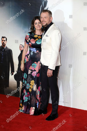 Stock Photo of Actor Simon Pegg and partner Maureen Pegg pose for photographers on arrival at the premiere of the film 'Mission: Impossible - Fallout', in London