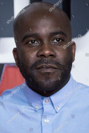 Melvin Odoom poses for photographers upon arrival at the premiere of the film 'Mission Impossible Fallout', in London