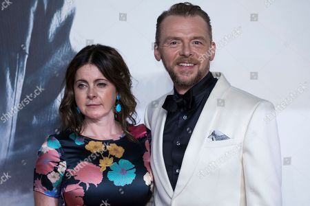 Stock Image of Actor Simon Pegg, right, and his wife Maureen Pegg pose for photographers upon arrival at the premiere of the film 'Mission Impossible Fallout', in London