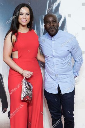 Melvin Odoom, right, poses for photographers upon arrival at the premiere of the film 'Mission Impossible Fallout', in London