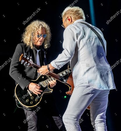 The English-American rock band Foreigner with rhythm guitarist Bruce Watson and lead guitarist and band founder Mick Jones performs at the Blue Hills Bank Pavilion, in Boston as part of The Juke Box Heroes Tour