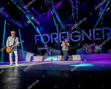 Stock Image of The English-American rock band Foreigner with founder and lead guitarist Mick Jones, keyboardist Michael Bluestein, lead vocalist Kelly Hansen and drummer Chris Frazier performs at the Blue Hills Bank Pavilion, in Boston as part of The Juke Box Heroes Tour