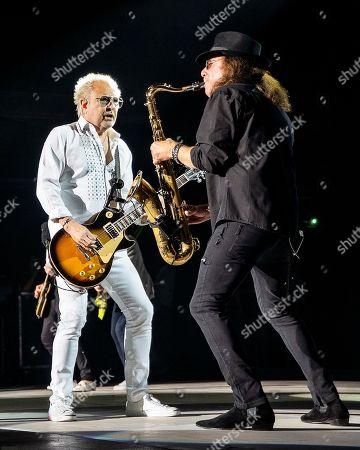 The English-American rock band Foreigner founder and lead guitarist Mick Jones and sax player Thom Gimbel performs at the Blue Hills Bank Pavilion, in Boston as part of The Juke Box Heroes Tour