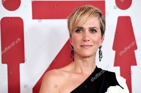 """Kristen Wiig, a cast member in """"Downsizing,"""" poses at a special screening of the film at the Regency Village Theatre in Los Angeles. Wiig does not look much like a villain in a photo released for """"Wonder Woman 1984."""" Director Patty Jenkins, tweeted the first look at Wiig as Wonder Woman's foe, Cheetah. Wiig is dressed as Barbara Minerva, the mortal who morphs into a powerful nemesis"""