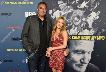 """Brad Garrett, left, and IsaBeall Quella arrive at the Los Angeles premiere of """"Robin Williams: Come Inside My Mind"""" at the TCL Chinese Theatre on"""