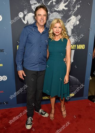 """Kevin Nealon, left, and Susan Yeagley arrive at the Los Angeles premiere of """"Robin Williams: Come Inside My Mind"""" at the TCL Chinese Theatre on"""