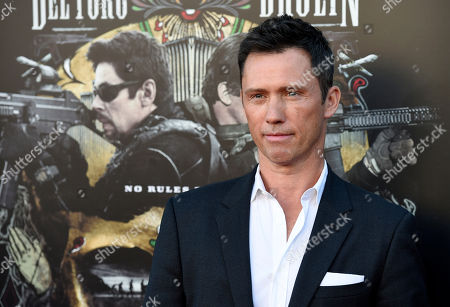 """Jeffrey Donovan, a cast member in """"Sicario: Day of the Soldado,"""" poses at the premiere of the film at the Westwood Regency Theatre, in Los Angeles"""