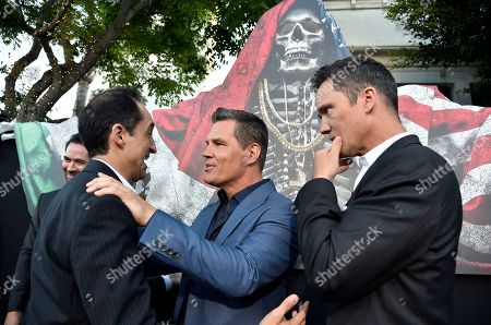 """Josh Brolin, center, a cast member in """"Sicario: Day of the Soldado,"""" mingles with fellow cast members Bruno Bichir, left, and Jeffrey Donovan at the premiere of the film at the Westwood Regency Theatre, in Los Angeles"""