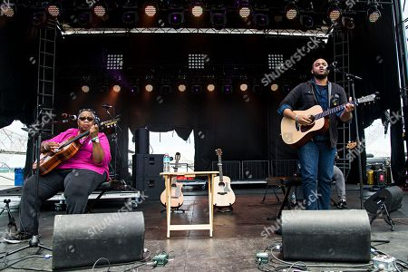 """Ruth Ward, left, and Madisen Ward of Madisen Ward and the Mama Bear perform at the Forecastle Music Festival in Louisville, Ky. The mother-and-son duo Madisen Ward & the Mama Bear offer excellent songs on new six-song, folk-roots EP, """"The Radio Winners"""