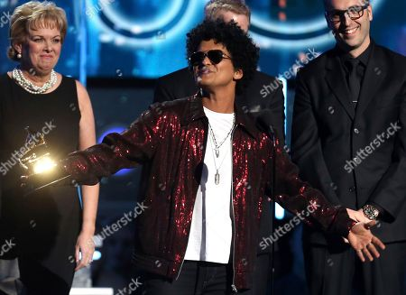 "Bruno Mars accepts the award for record of the year for ""24K Magic"" at the 60th annual Grammy Awards in New York. The Grammy Awards are extending the number of nominees in its top categories from five to eight"