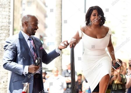 "Actress Niecy Nash, right, best known for her roles in ""Reno 911!"" and ""Claws,"" is helped on stage by her husband Jay Tucker during a ceremony honoring her with a star on the Hollywood Walk of Fame, in Los Angeles"