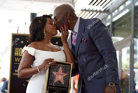 "Stock Photo of Actress Niecy Nash, left, best known for her roles in ""Reno 911!,"" ""Scream Queens"" and ""Claws,"" kisses her husband Jay Tucker while holding a replica of her star following a ceremony honoring her with a star on the Hollywood Walk of Fame, in Los Angeles"