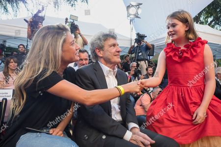 Stock Image of Cassidy Horn and Alan Horn congratulate Bronte Carmichael at the Christopher Robin World Premiere at Walt Disney Studios on in Burbank, Calif. The stars were out in force as the all new Nissan Kicks also made its debut and Disney rededicated their theater to be named after the famed Sherman Brothers