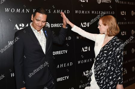 """Actors Michael Greyeyes, left, and Jessica Chastain pose together at a special screening of """"Woman Walks Ahead"""" at The Whitby Hotel, in New York"""