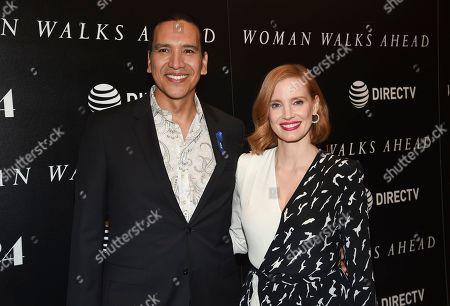 """Actors Michael Greyeyes, left, and Jessica Chastain pose together at a special screening of """"Woman Walks Ahead"""" at The Whitby Hotel on in New York"""