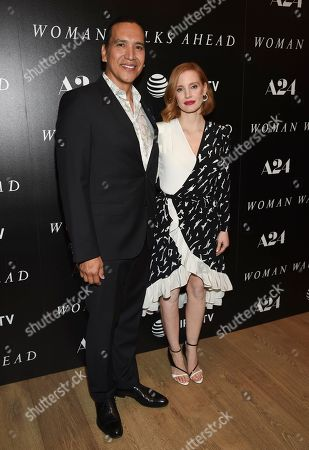 """Actors Michael Greyeyes, left, and Jessica Chastain pose together at a special screening of """"Woman Walks Ahead"""" at The Whitby Hotel on Tuesday, June 26, in New York"""