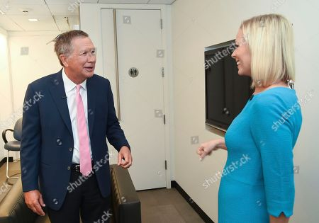 """Television journalist Margaret Hoover, right, greets her first guest Republican Gov. John Kasich before a taping of PBS's new public affairs show """"Firing Line with Margaret Hoover"""" at Tisch WNET Studios, in New York"""