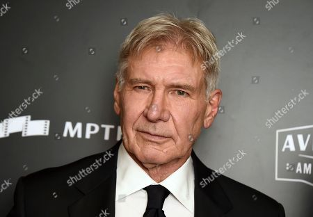 "Harrison Ford poses in the press room at the Hollywood Film Awards at the Beverly Hilton hotel in Beverly Hills, Calif. The ""Star Wars"" and ""Indiana Jones"" star, stopped for some pizza in Amherst, Mass., along with his wife, ""Ally McBeal"" star Calista Flockhart and their son"