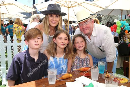"""David Koechner, Leigh Koechner and family seen at the premiere of """"Dog Days"""" at the Westfield Century City Mall, in Los Angeles"""