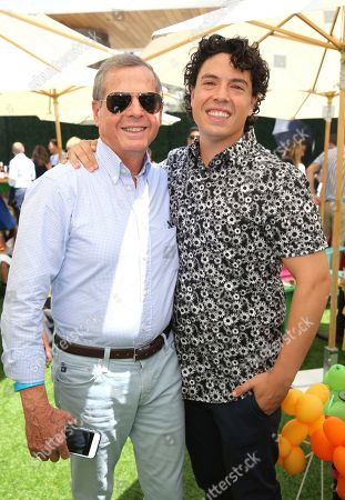 """Jon Bass and his father seen at the premiere of """"Dog Days"""" at the Westfield Century City Mall, in Los Angeles"""