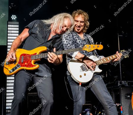 American rock band REO Speedwagon, with bass player Bruce Hall and lead guitarist Dave Amato, performs at the Xfinity Center, in Mansfield, Mass