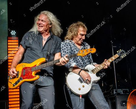 Stock Photo of The American iconic rock band REO Speedwagon with bass player Bruce Hall and lead guitarist Dave Amato performs at the Xfinity Center, in Mansfield, Mass