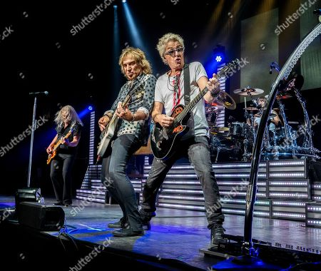 The American iconic rock band REO Speedwagon with bass player Bruce Hall, lead guitarist Dave Amato, lead vocalist and guitarist Kevin Cronin and drummer Bryan Hitt performs at the Xfinity Center, in Mansfield, Mass