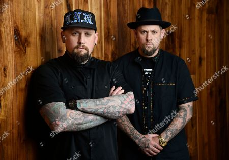 Benji Madden, left, and his twin brother Joel Madden of the band Good Charlotte pose for a portrait, in Burbank, Calif. The city of Annapolis, Md. will hold a benefit concert on July 28 featuring the Maryland-based band to honor the five Capital Gazette employees killed in an attack in their newsroom