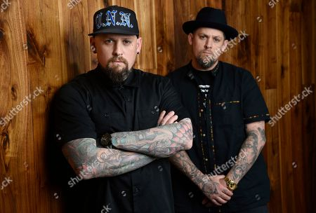 Benji Madden, left, and his twin brother Joel Madden of the rock band Good Charlotte pose for a portrait, in Burbank, Calif. The city of Annapolis, Md. will hold a benefit concert on July 28 featuring the Maryland-based band to honor the five Capital Gazette employees killed in an attack in their newsroom