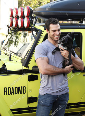 Dr. Evan Antin, celebrity vet and car enthusiast, poses with Super 8's ROADM8, a road-trip-ready concept car based on the hotel brand's new guest room redesign, in Los Angeles. Highlighting the best the brand has to offer through more than $100 million in recent renovations, the car's unique features include hotel bedding turned upholstery, an in-console mini fridge, built-in coffee maker, tablet entertainment and more. Visit super8.com/ROADM8 to learn more