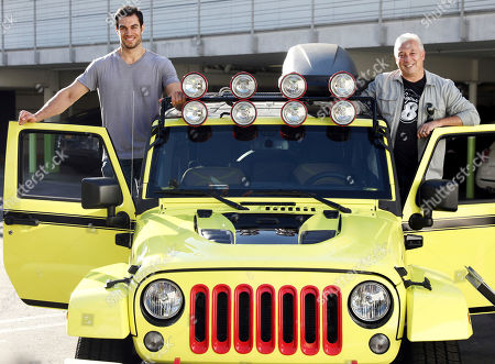 Stock Photo of Dr. Evan Antin, celebrity vet and car enthusiast, left, and Mike Mueller, Super 8 brand senior vice president, pose with ROADM8, Super 8's road-trip-ready concept car, in Los Angeles, . Built to creatively highlight the best of the brand's newly redesigned guest rooms, the car's unique features include hotel bedding turned upholstery, an in-console mini fridge, built-in coffee maker, tablet entertainment and more. Visit super8.com/ROADM8 to learn more