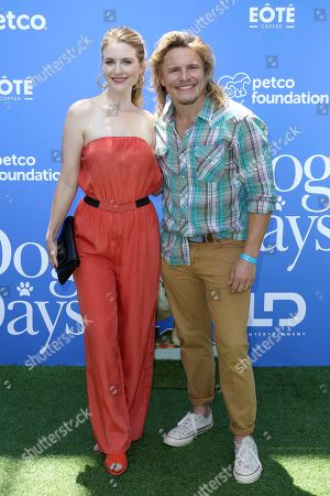 """Tony Cavalero, left, and Annie Cavalero arrive at the World Premiere of """"Dog Days"""" at the Atrium at Westfield Century City, in Los Angeles"""