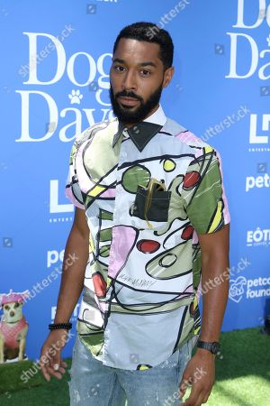 "Tone Bell arrives at the World Premiere of ""Dog Days"" at the Atrium at Westfield Century City, in Los Angeles"