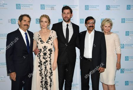 "Actors Emily Blunt and John Krasinski pose with honorees john Stossel, left, Ziauddin Yousafzai and Tina Brown at the 12th annual American Institute for Stuttering ""Freeing Voices Changing Lives"" benefit gala at Guastavino's, in New York"