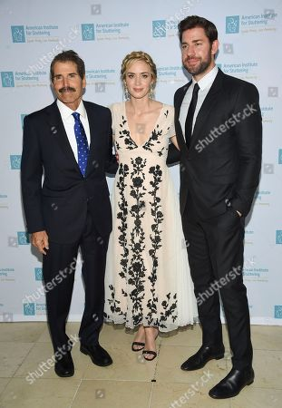 """Actors Emily Blunt and John Krasinski pose with honorees john Stossel, left, at the 12th annual American Institute for Stuttering """"Freeing Voices Changing Lives"""" benefit gala at Guastavino's, in New York"""