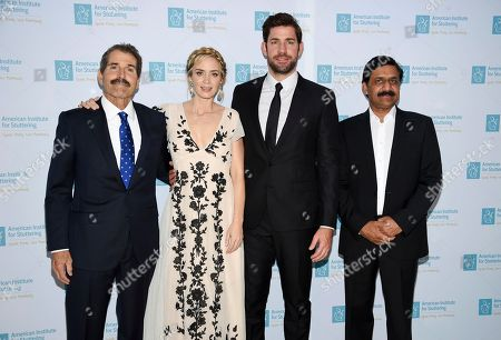 "Actors Emily Blunt and John Krasinski pose with honorees john Stossel, left, and Ziauddin Yousafzai at the 12th annual American Institute for Stuttering ""Freeing Voices Changing Lives"" benefit gala at Guastavino's, in New York"