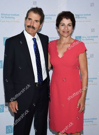 """Honoree John Stossel, left, and AIS director Dr. Heather Grossman pose together at the 12th annual American Institute for Stuttering """"Freeing Voices Changing Lives"""" benefit gala at Guastavino's, in New York"""