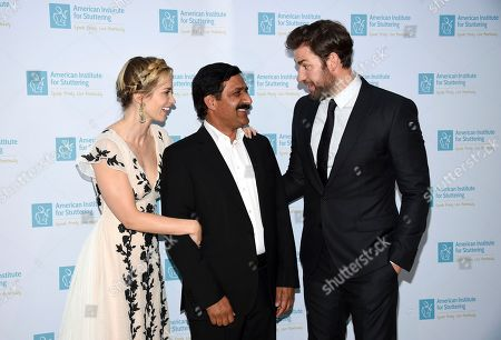 "Stock Picture of Actress Emily Blunt, left, honoree Ziauddin Yousafzai and actor John Krasinski attend the 12th annual American Institute for Stuttering ""Freeing Voices Changing Lives"" benefit gala at Guastavino's, in New York"